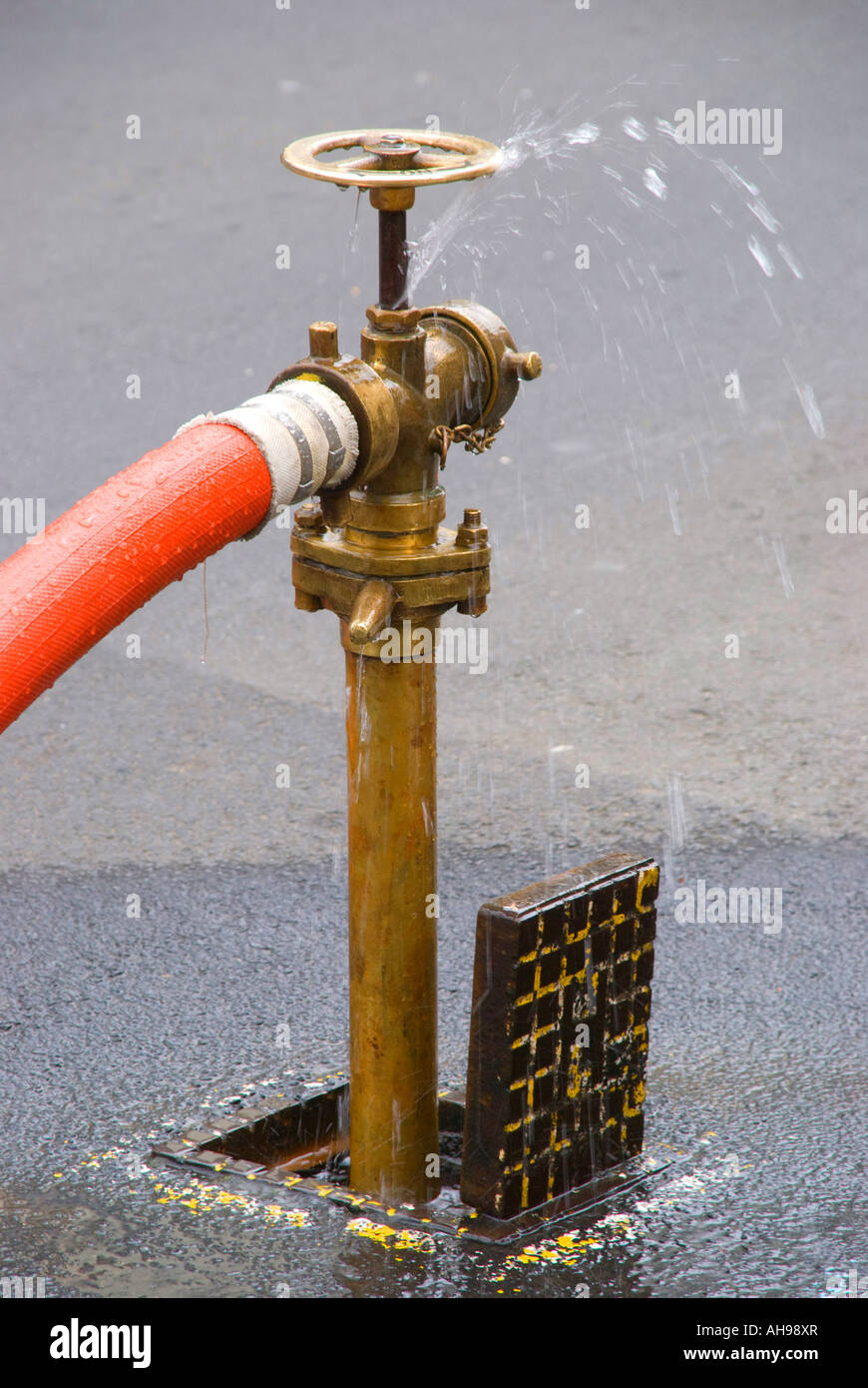A fire hydrant in use - Stock Image