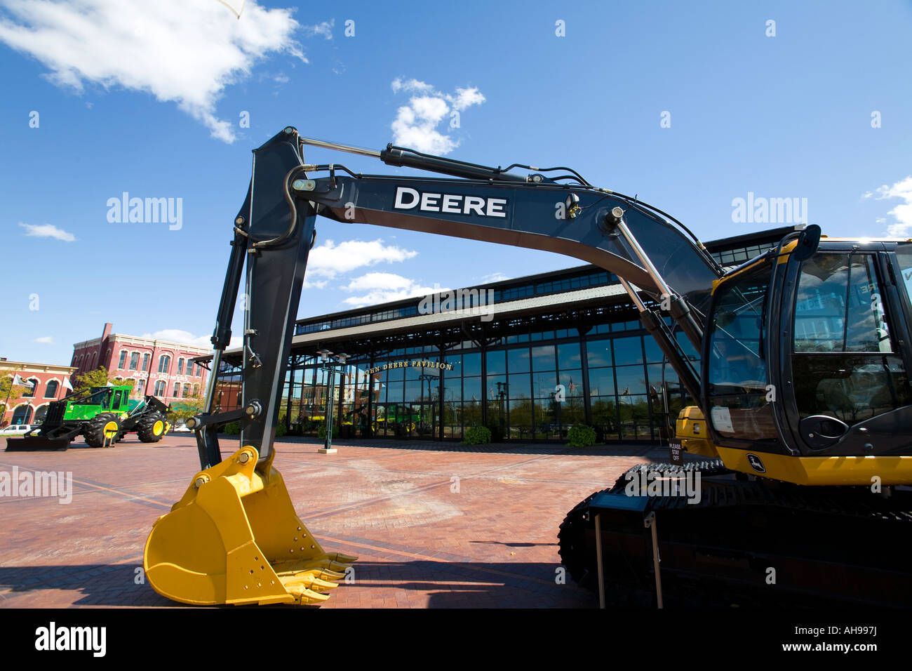 ILLINOIS Moline Earth moving equipment and a tractor in plaza outside John Deere Pavilion - Stock Image