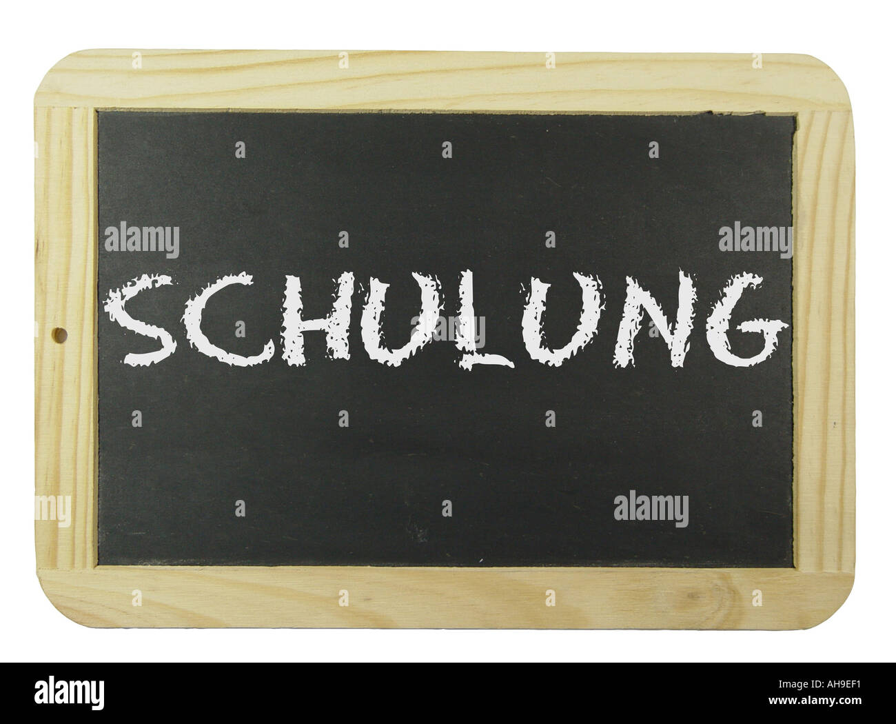 Chalk board with the label training Symbol for school learning and instruction Stock Photo