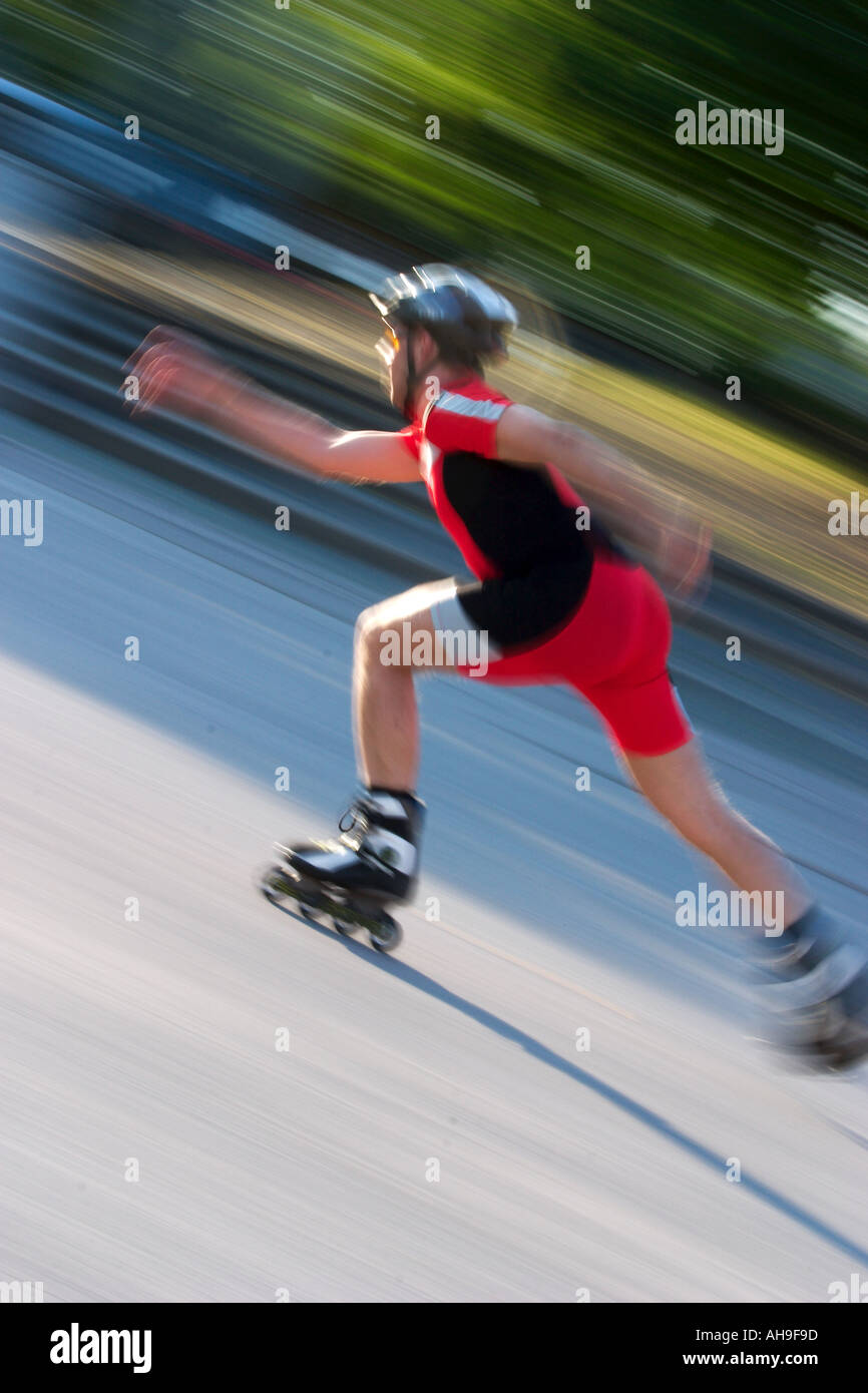 Blured picture of an fast driving sport inline skater in the olympic parc Munich MR Stock Photo