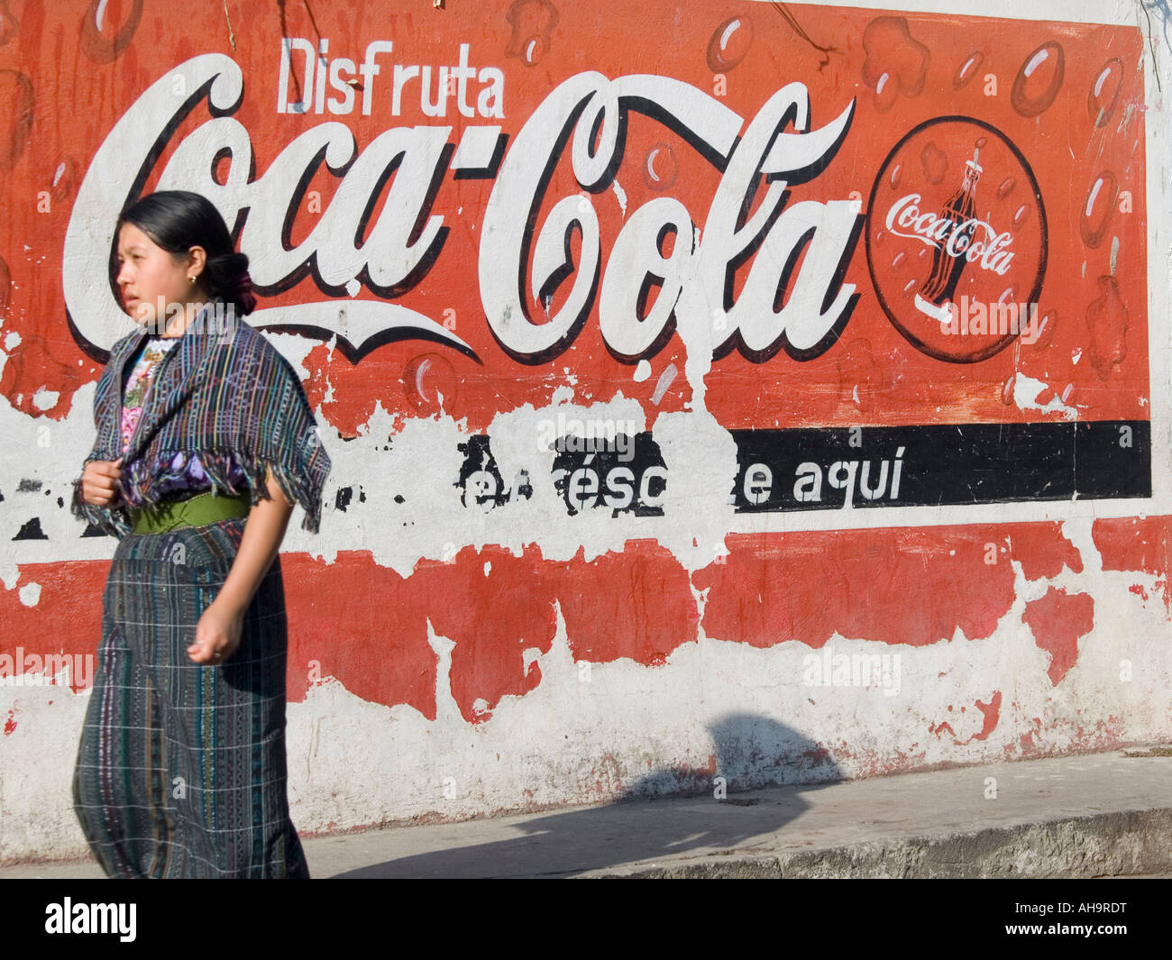 Logos of global symbols contrast with local culture in the highlands of Guatemala in Santiago Atitlan Guatemala - Stock Image