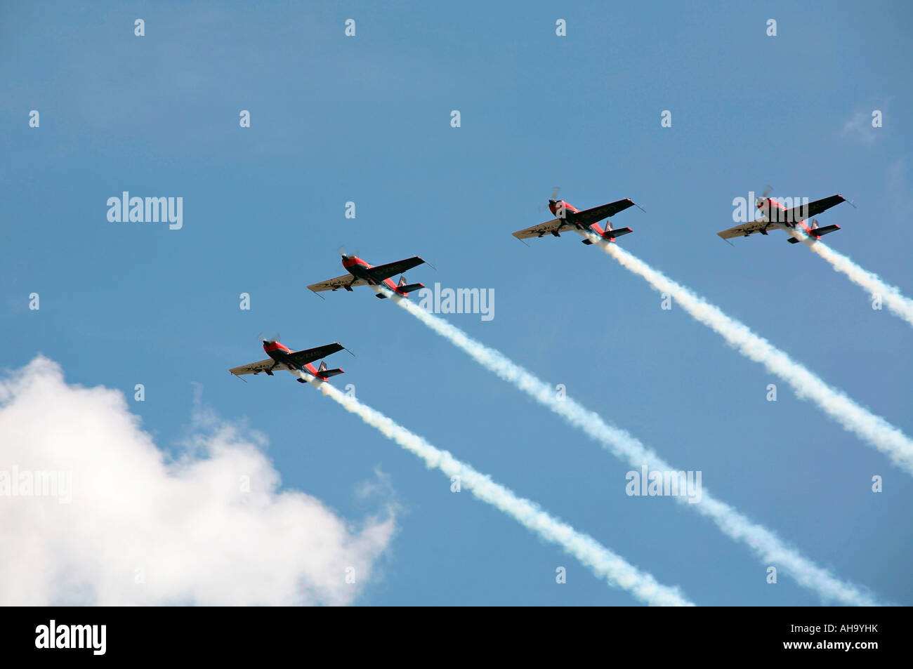 Blades aerobatic display team flying in four Extra 300LP aircraft - Stock Image