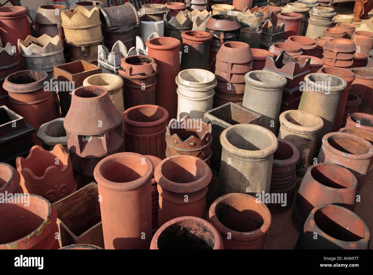 An array of old chimney pots. - Stock Image