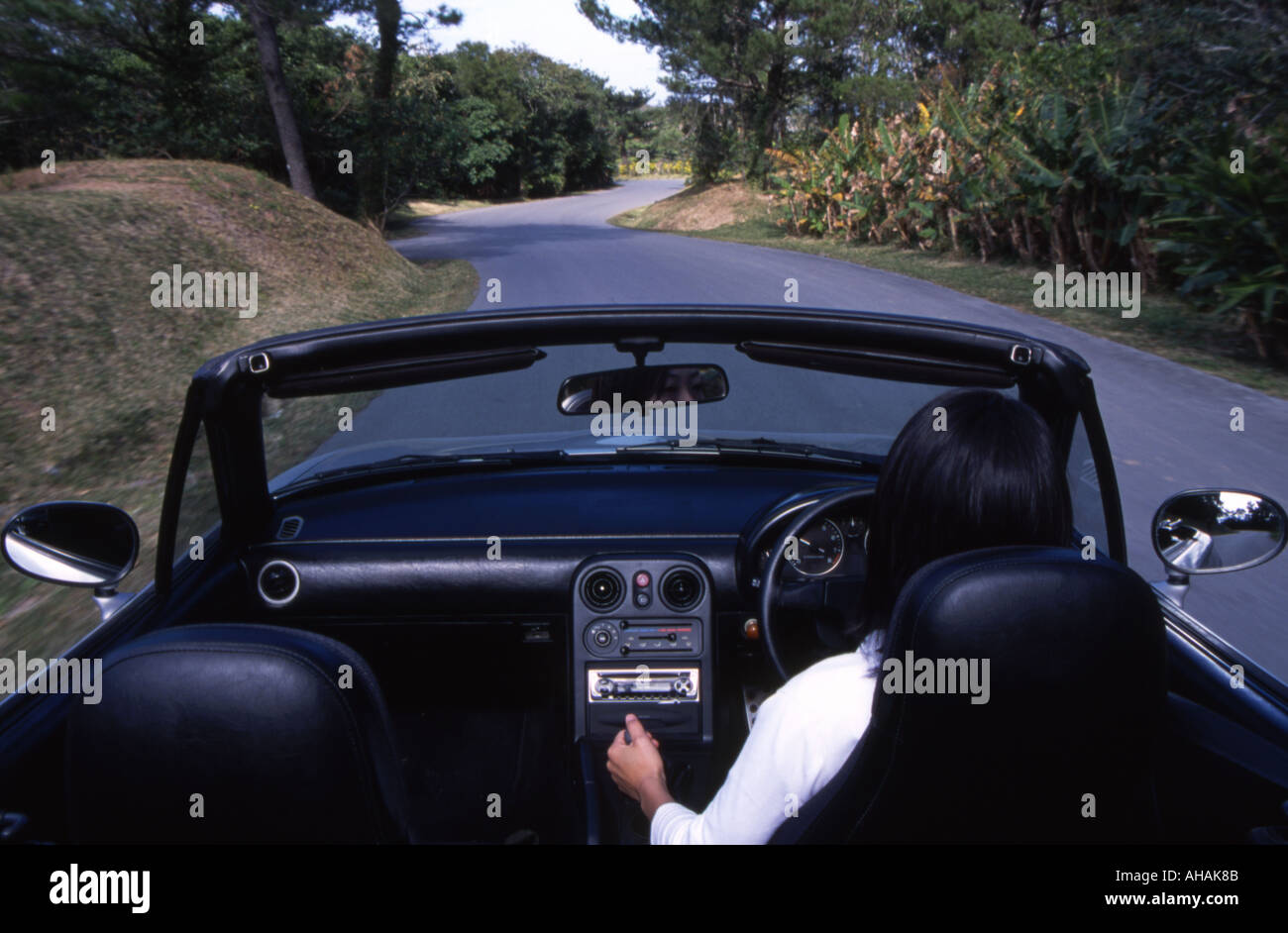 https://c8.alamy.com/comp/AHAK8B/japanese-girl-driving-a-1989-mazda-miata-mx5-mx-5-eunos-roadster-convertible-AHAK8B.jpg