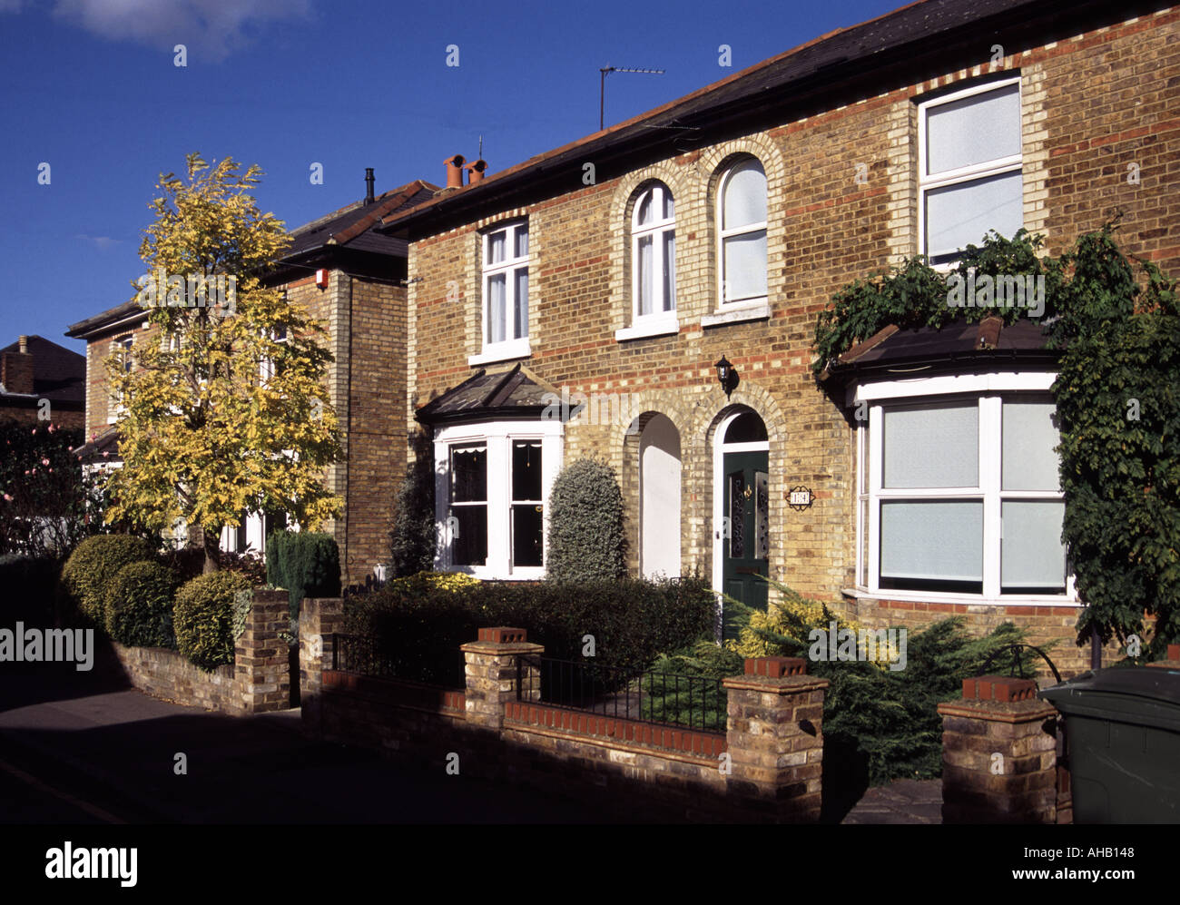 Housing Victorian semi detatched brick house with PVC windows - Stock Image