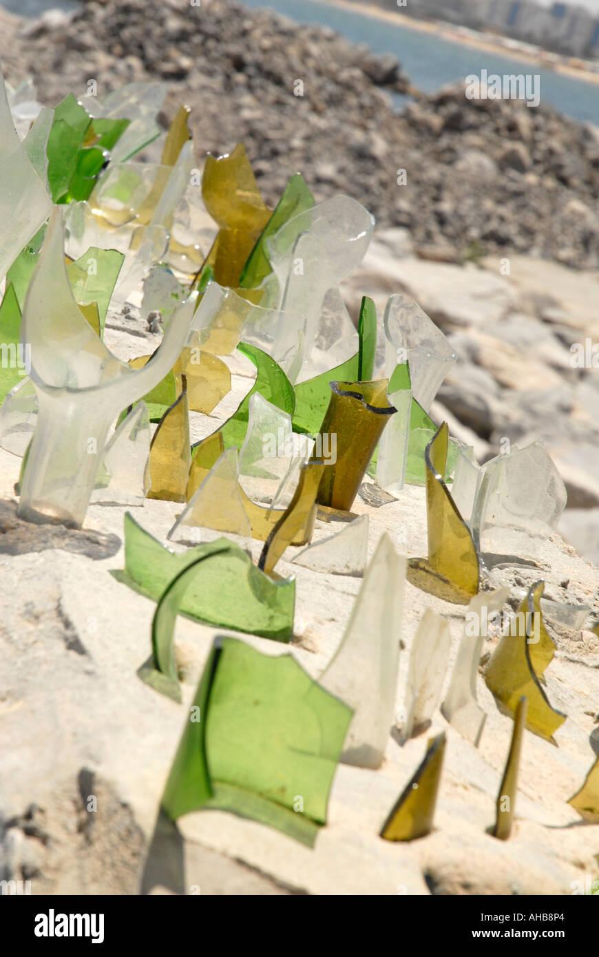 Broken Glass Bottles Wall Stock Photos & Broken Glass Bottles Wall ...