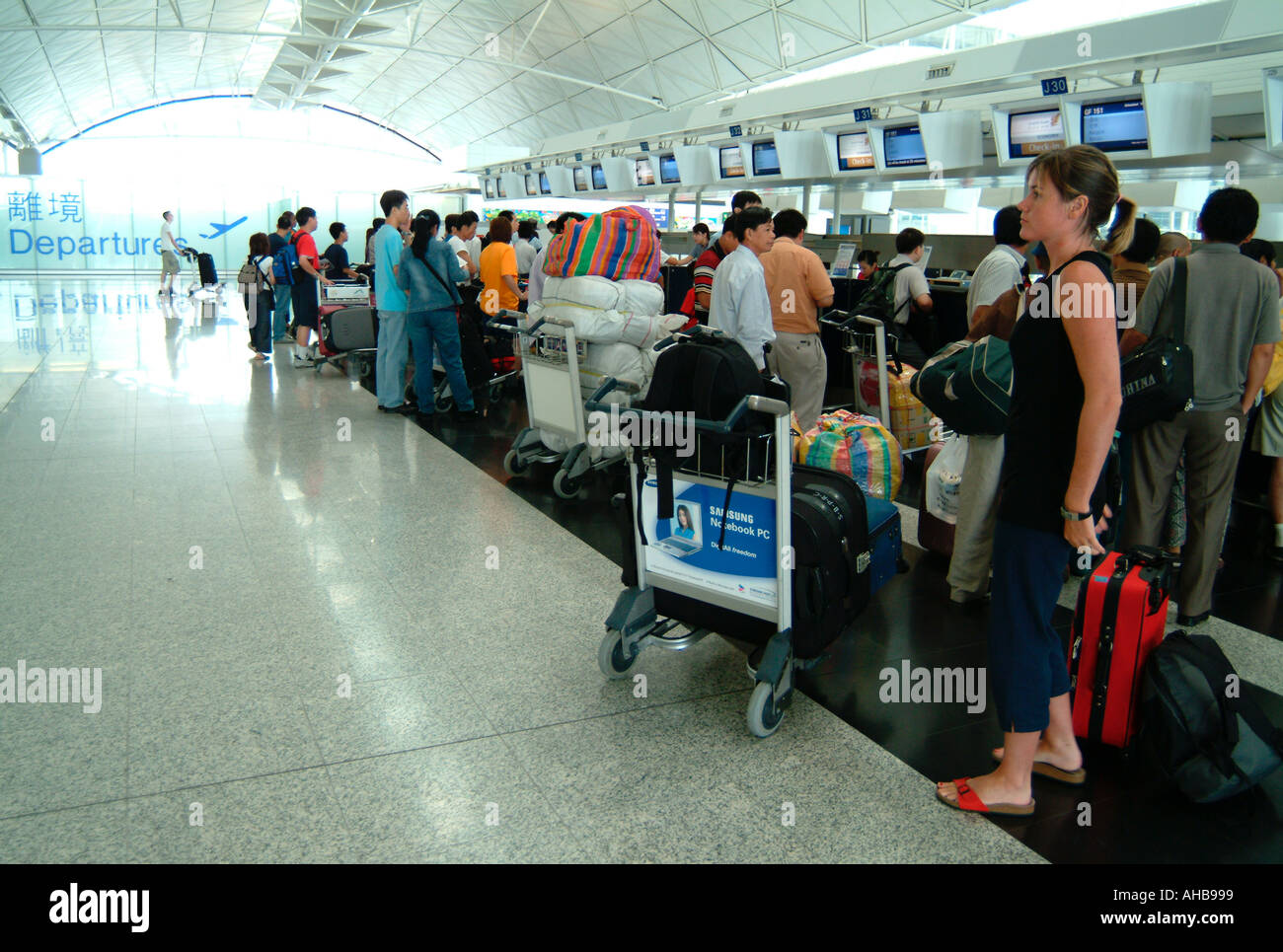 Hong Kong International Airport Chek Lap Kok check in desk - Stock Image