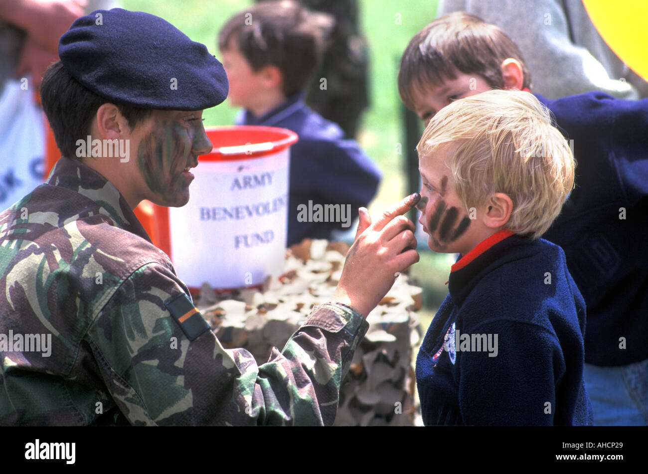 Army stand with face painting by female Army member at Devon County Show Exeter - Stock Image