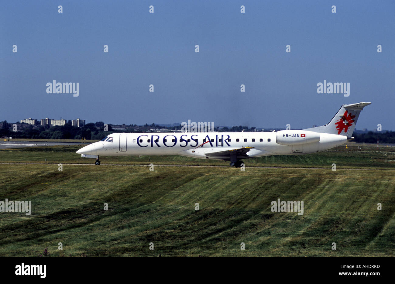 Cross Air Embraer RJ145 aircraft taxiing at Birmingham International Airport, West Midlands, England, UK - Stock Image
