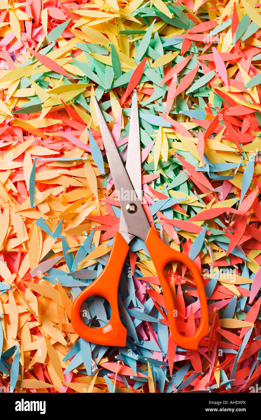 Scissors on pile of shredded paper - Stock Image