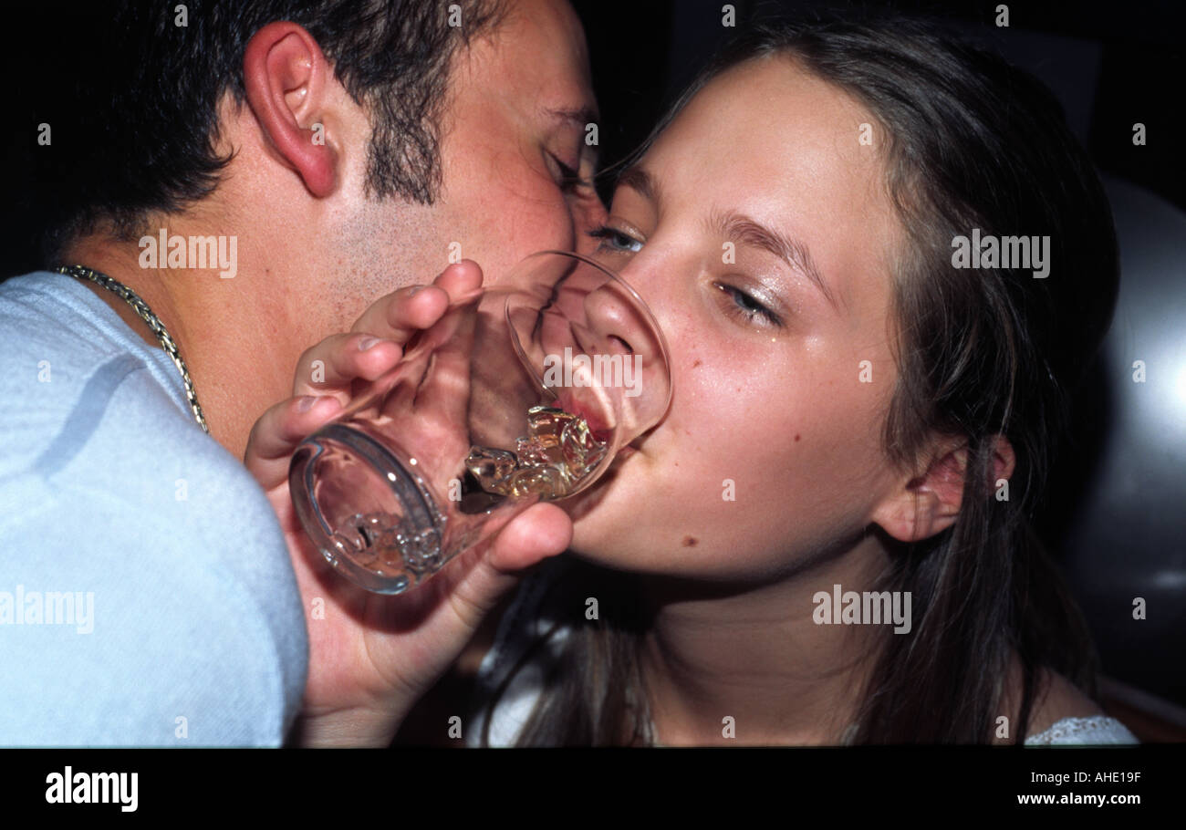 Teenager Girl Drinking Alcohol in Bar - Stock Image