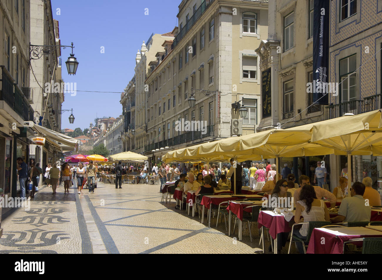 Lisbon Portugal Rua Augusta street in the baixa district looking towards Rossio, with street restaurants at lunchtime - Stock Image
