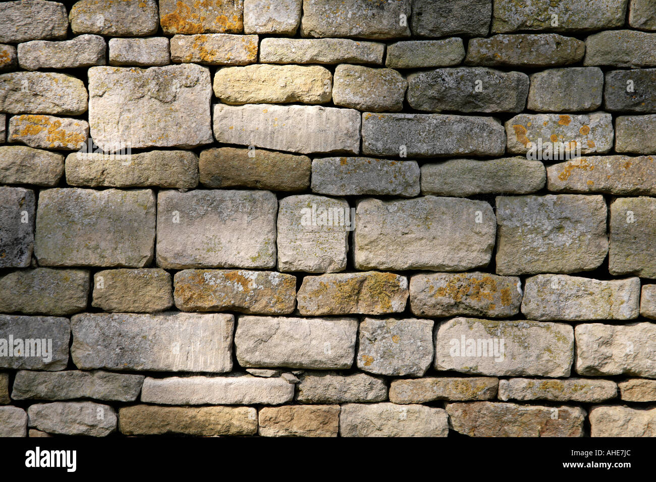 Stock Photo of a Cotswold Dry-Stone Wall - Stock Image