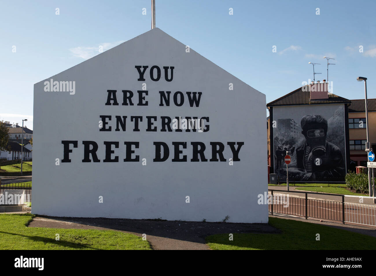 you are now entering free derry gable wall painting with petrol bomber mural in the background at free derry corner - Stock Image