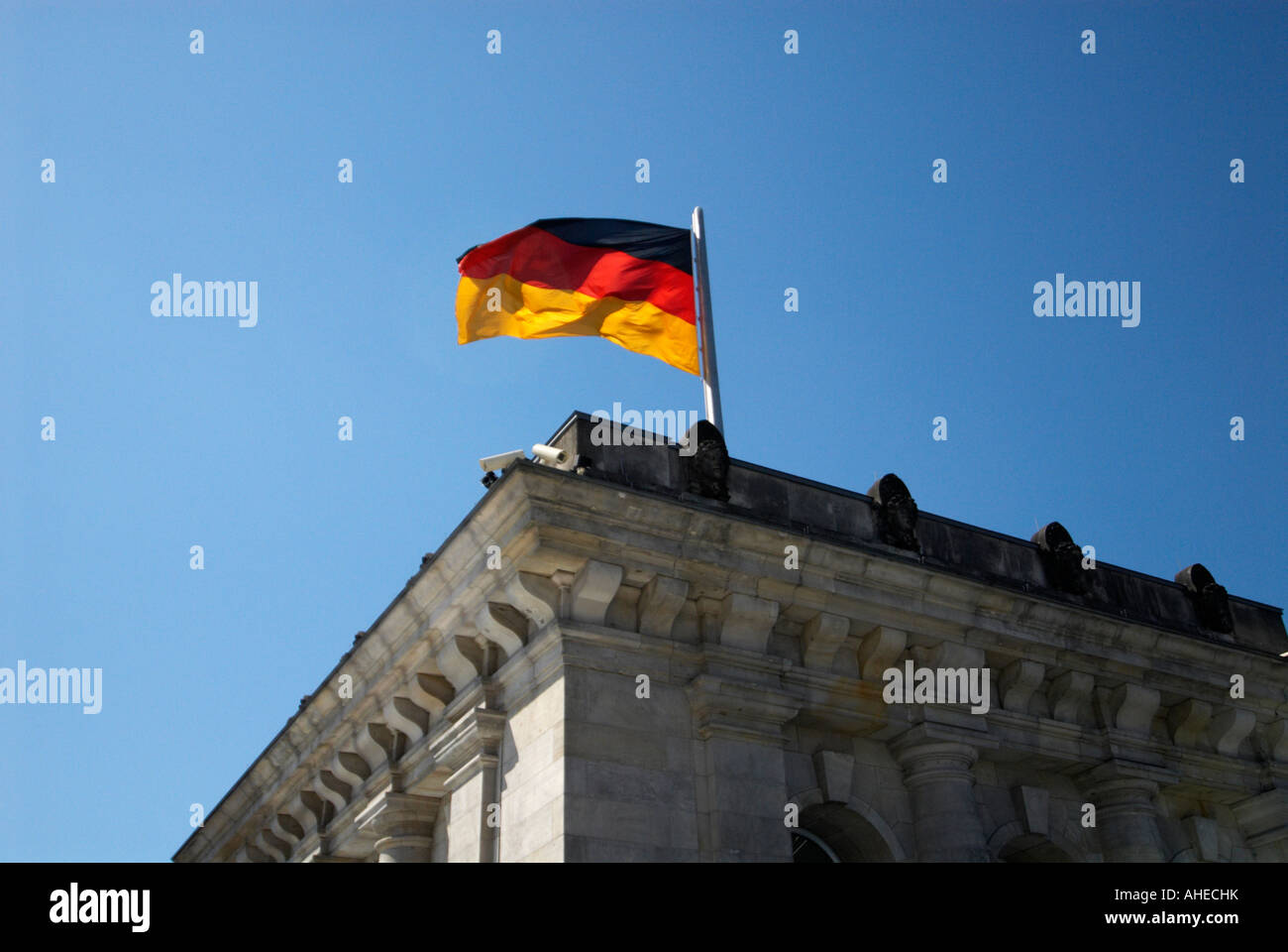 German flag on the parliament building in Berlin - Stock Image