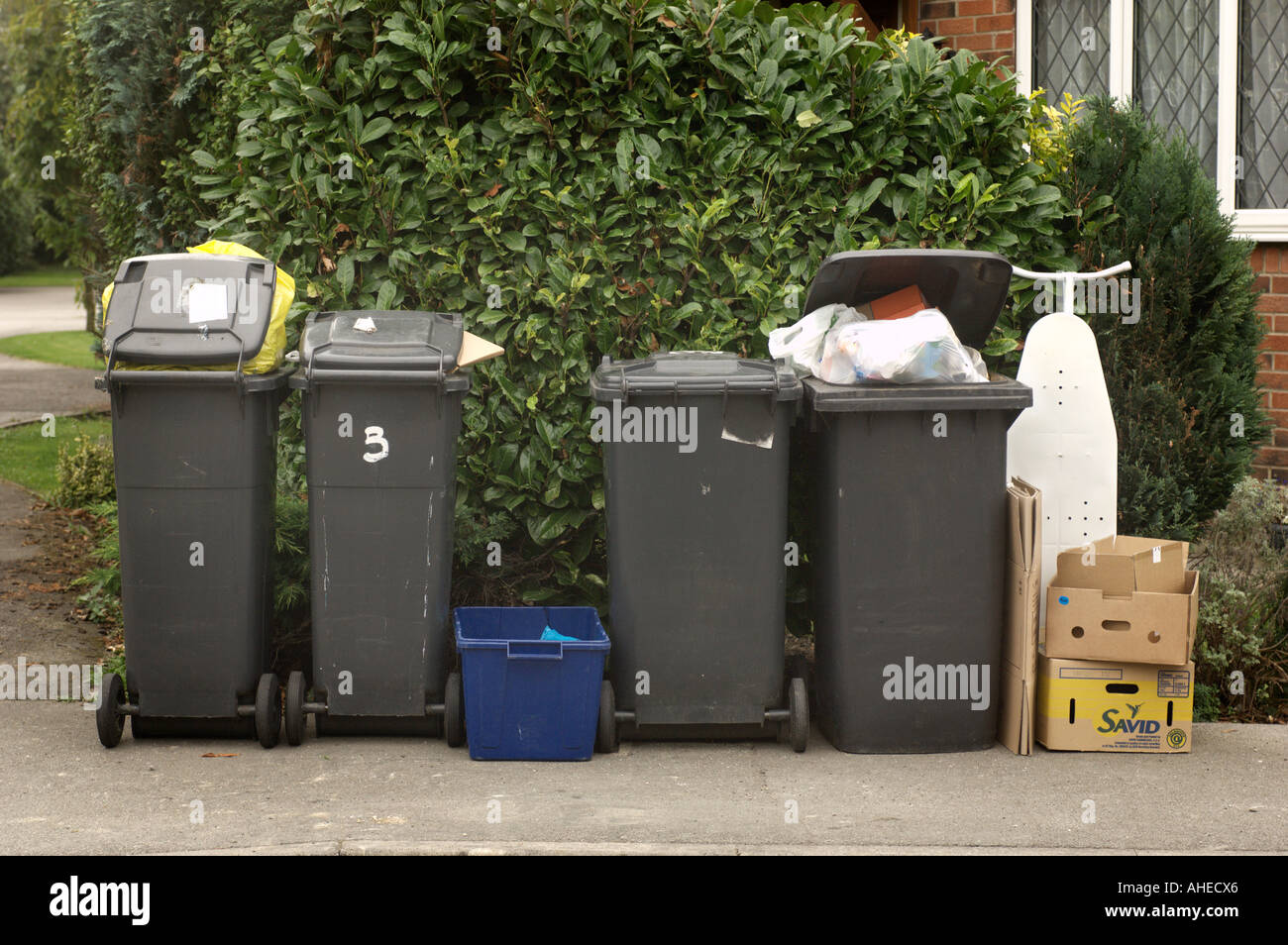 row of wheely bins waiting to be emptied Stock Photo