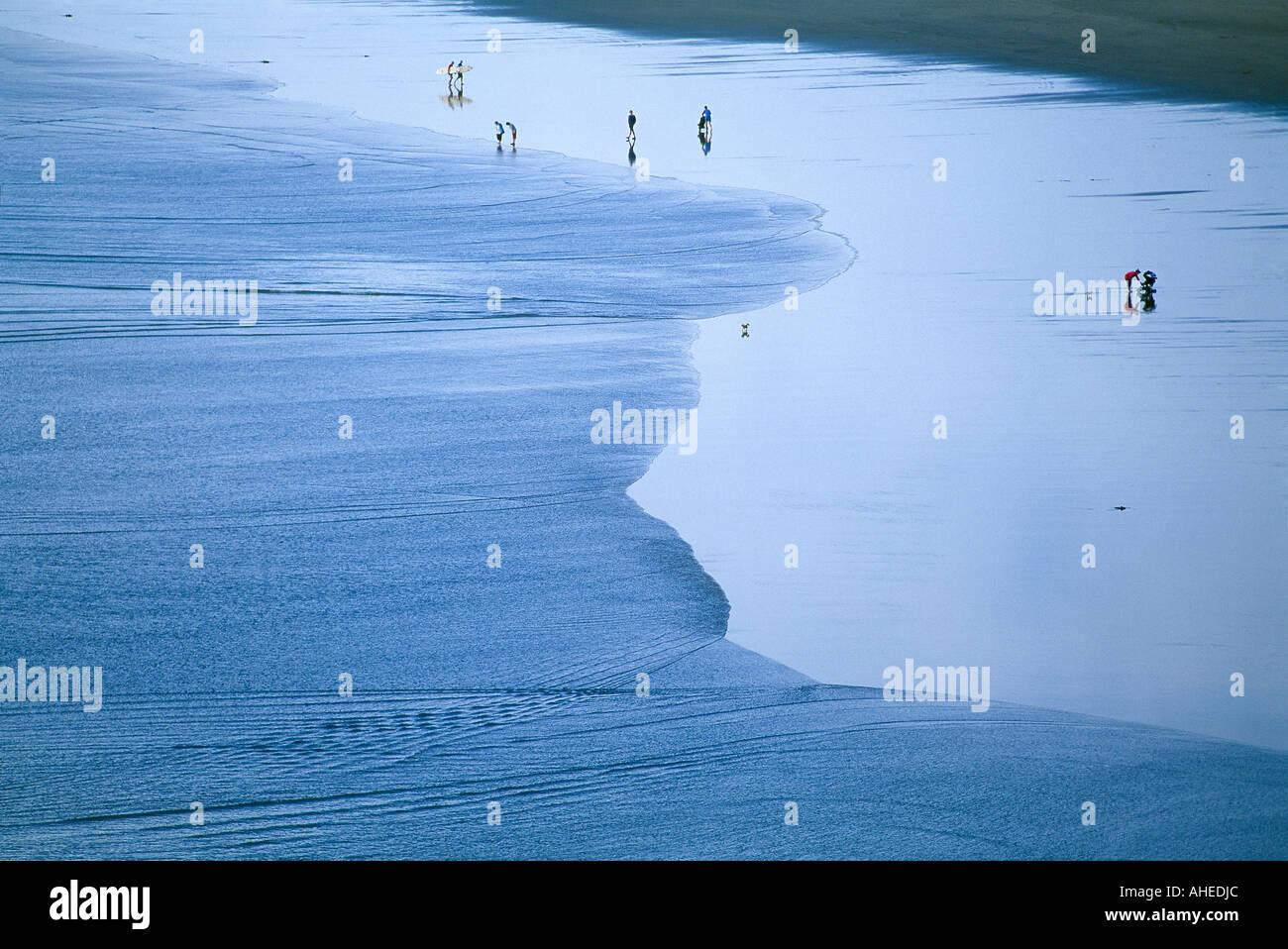 figures on the beach at Murawai North Island New Zealand - Stock Image