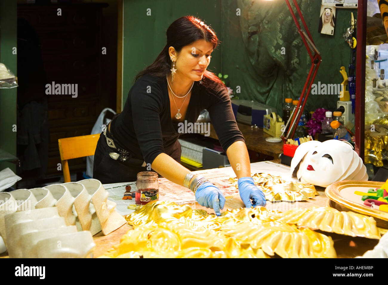 Venetian carnival masks being handmade by woman in shop Venice Veneto Italy Europe EU - Stock Image