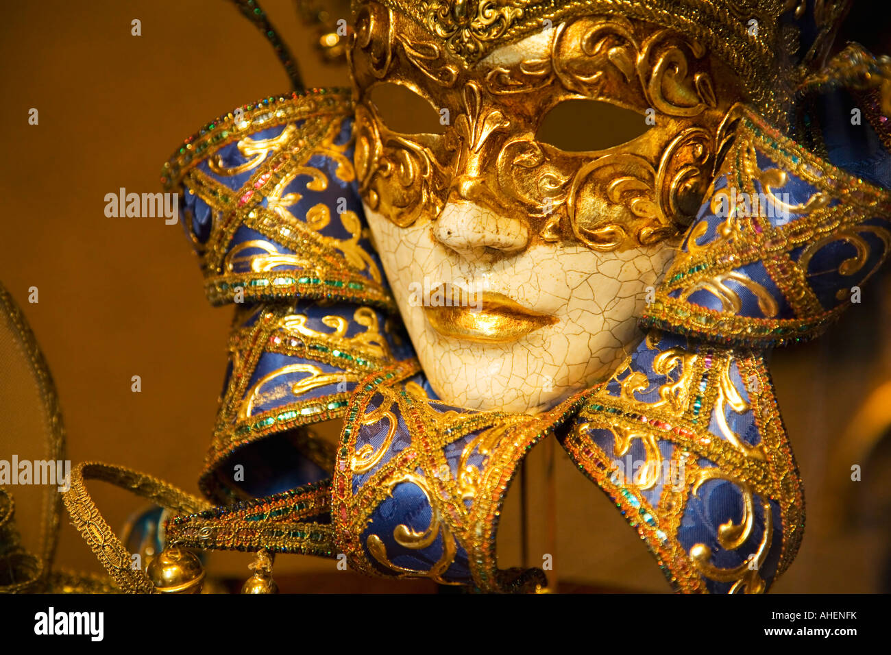 Venetian carnival mask in blue and gold womans handmade in shop window Venice Italy Europe EU - Stock Image
