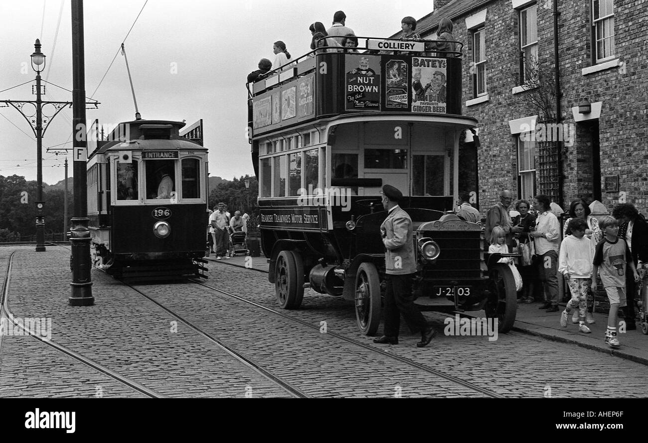 Old open top bus and later tram car at Beamish open air museum near Newcastle - Stock Image