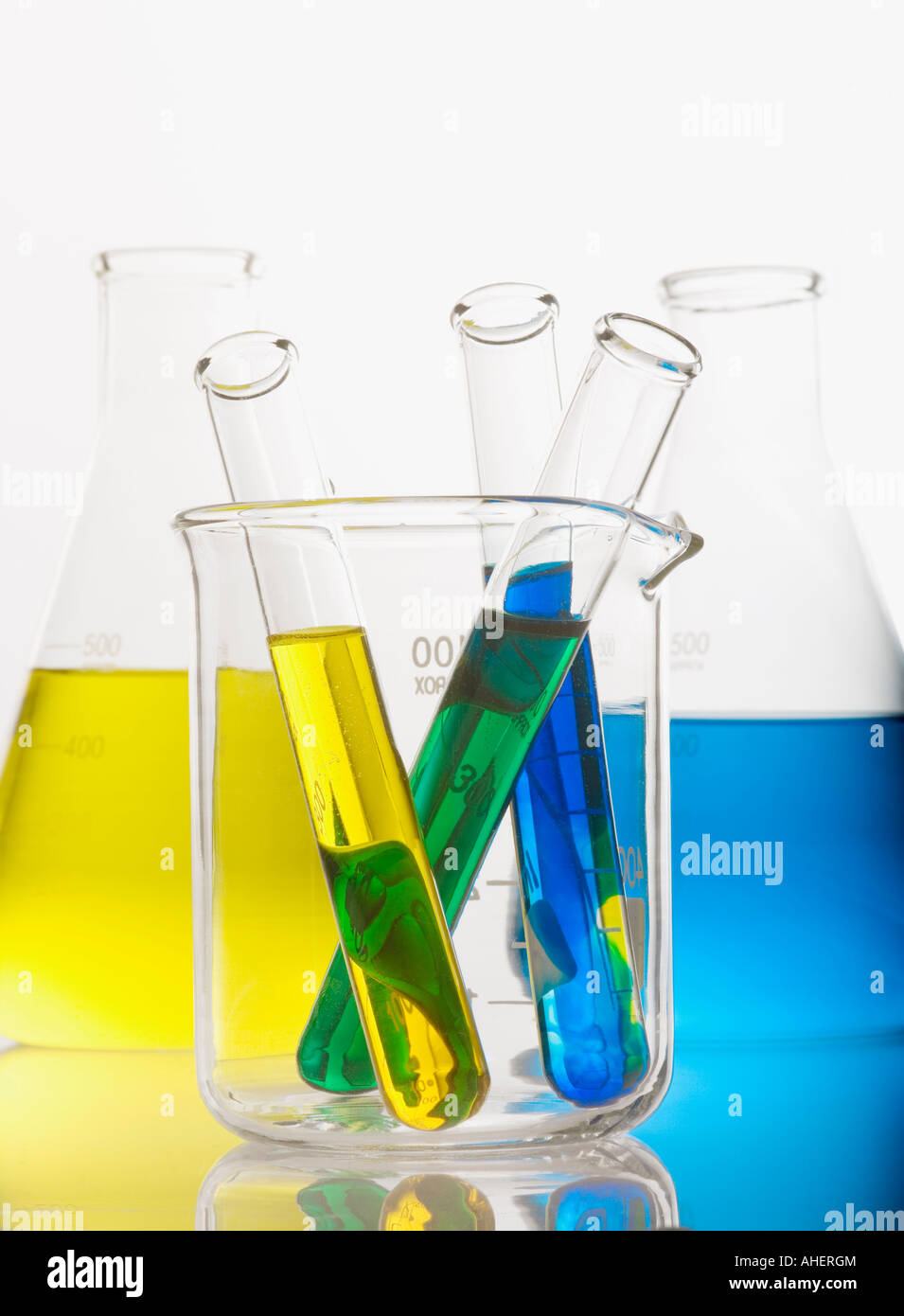 Test tubes and flasks with colorful solutions - Stock Image