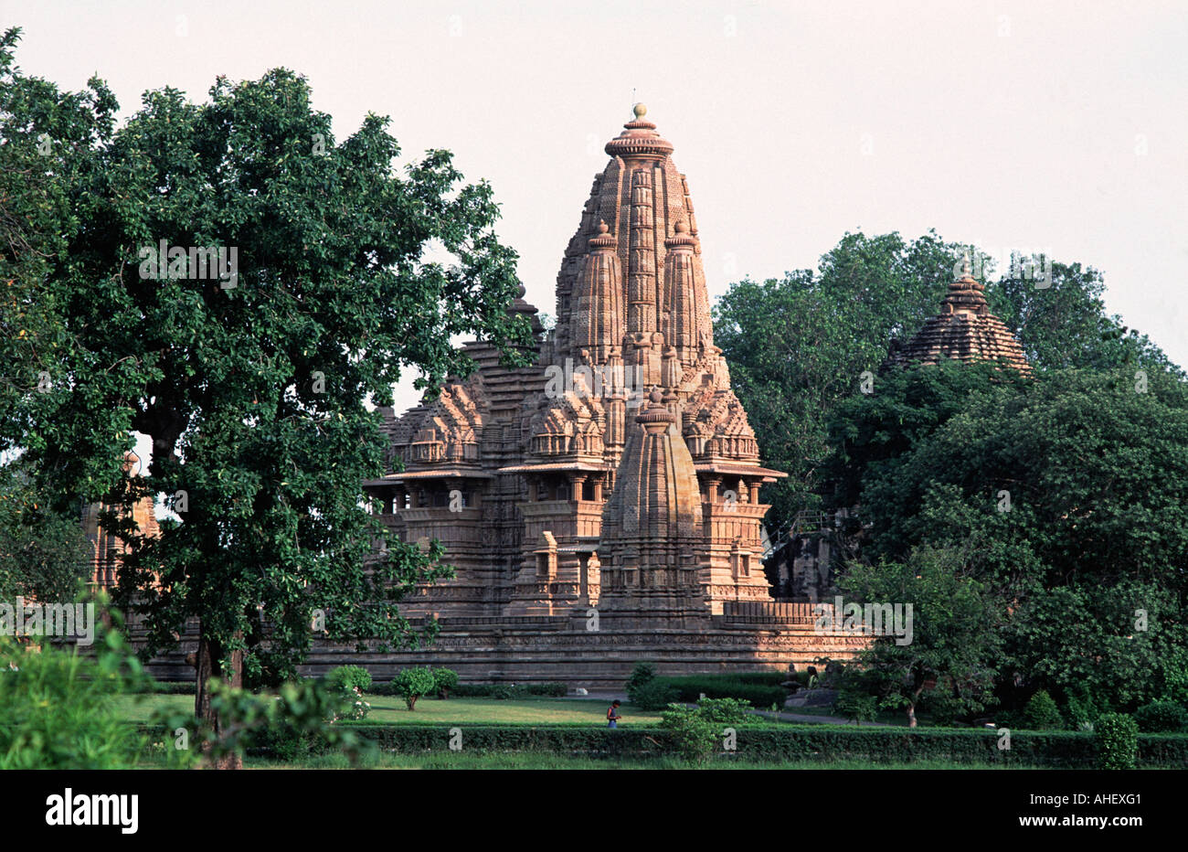 Khajuraho is set in lush grounds The site is reknowned for the tone masonry depicted on it s temple walls Madhya Pradseh INDIA - Stock Image