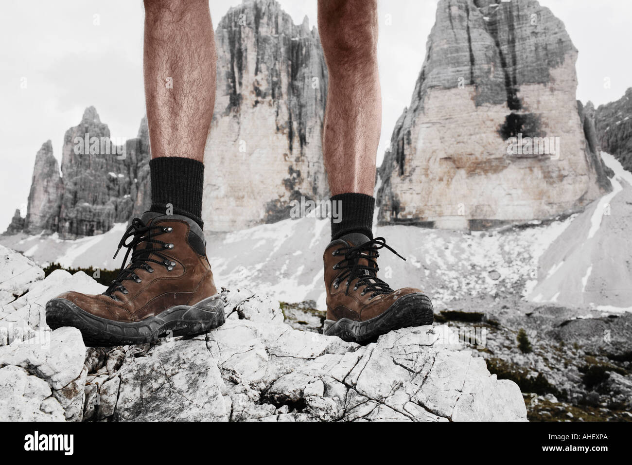 Shoes Of Mountain Climber Standing In Front Of Summits Tre Cime Three Peaks Dolomites Alps Italy - Stock Image