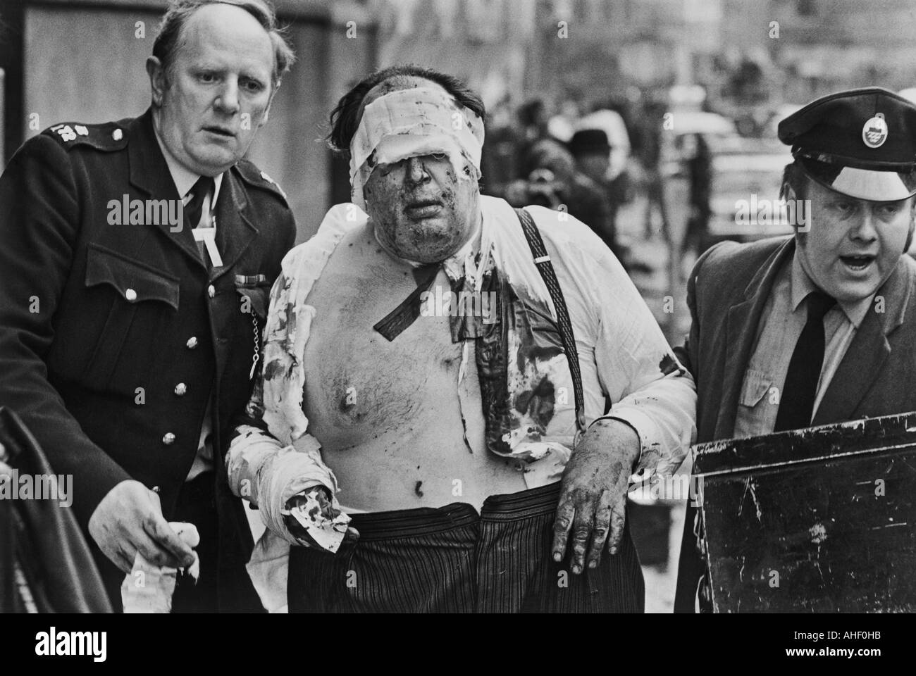A barrister being helped to safety after the IRA bombed the Old Bailey on 8 March 1973 - Stock Image