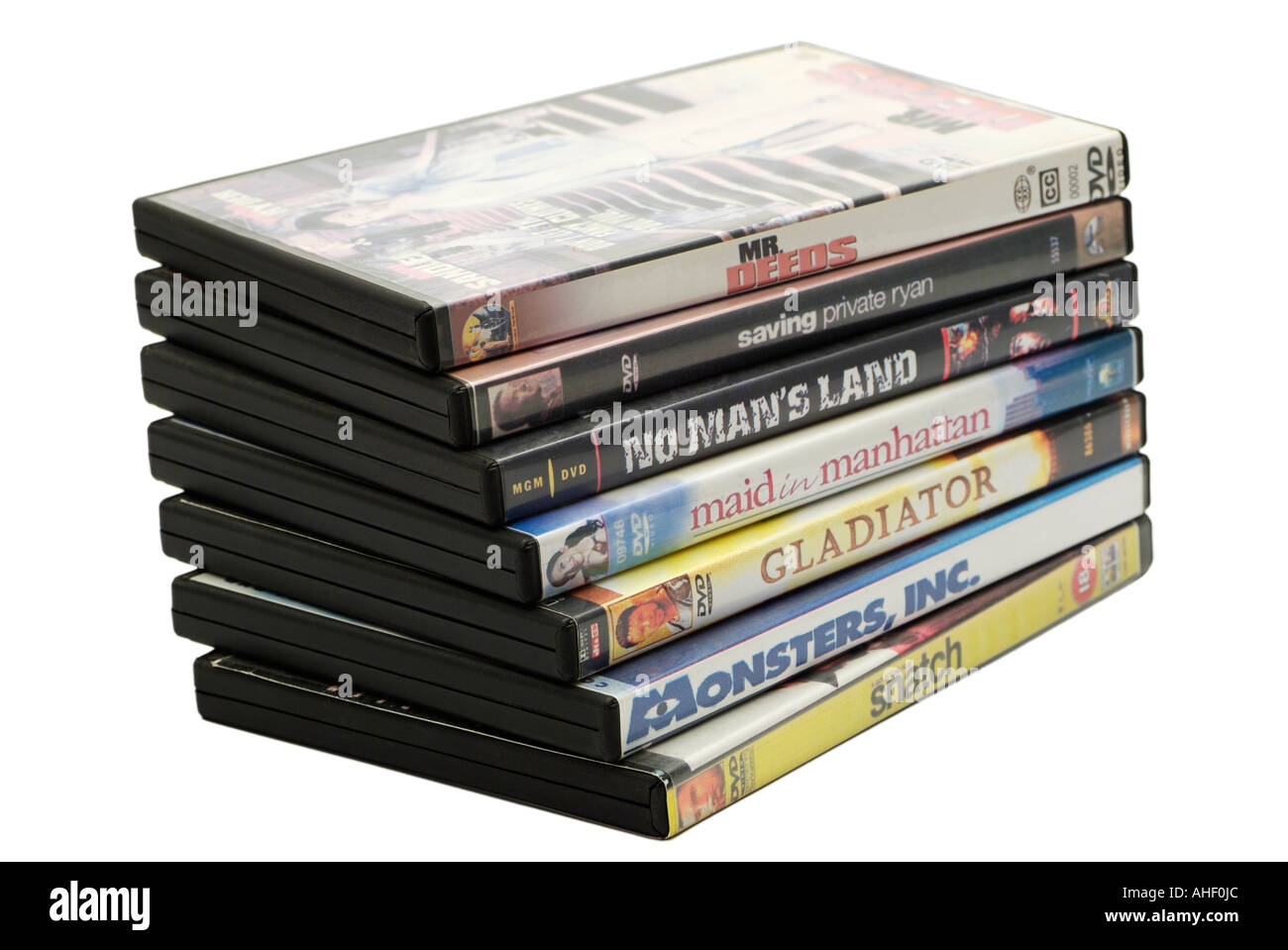Stack of DVD Movies Against a White Background - Stock Image