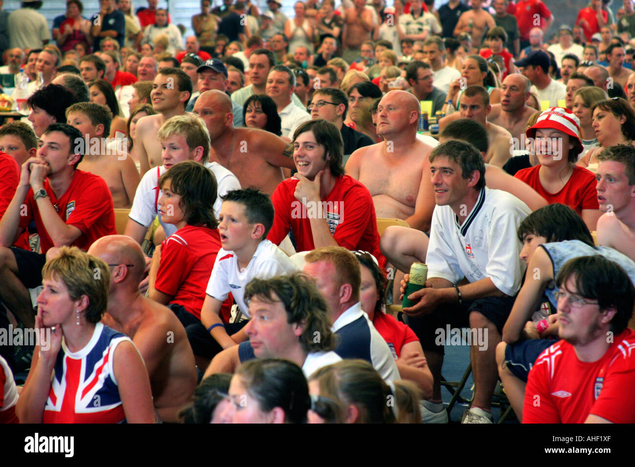 People watching live footage of World Cup football match - England versus Portugal - on a large screen in large hall. Malvern UK - Stock Image