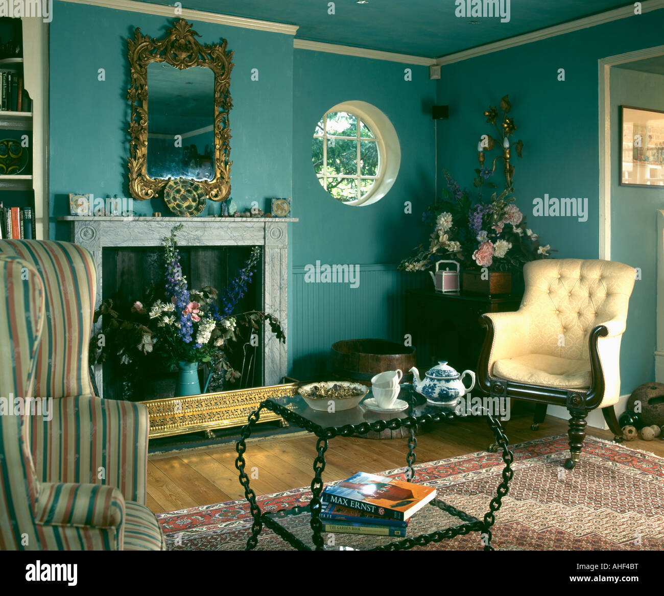 Green Nineties Livingroom With Cream Victorian Armchair And Glass Stock Photo Alamy