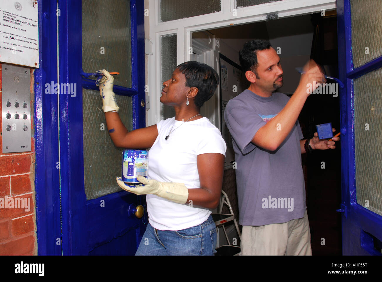 Management workers from Starbuck s coffee chain doing voluntary work for Balham Community Centre, south London, - Stock Image