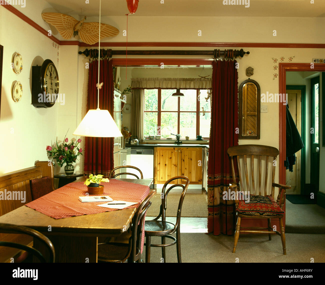 Windsor Chair In Dining Room With Pendant Light Over Rectangular Stock Photo Alamy
