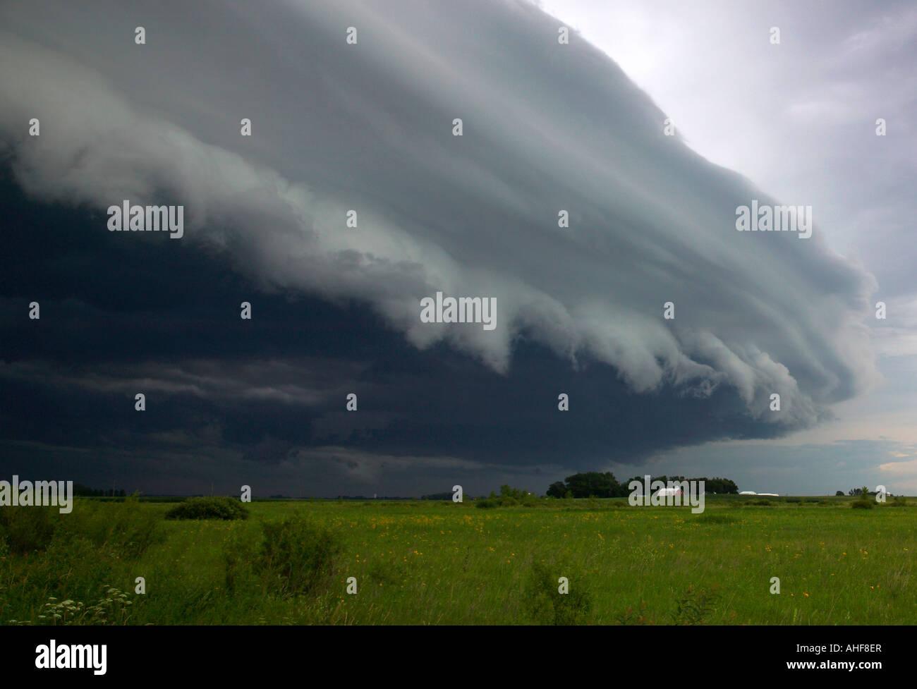 shelf cloud over prairie and farm, Minnesota USA - Stock Image