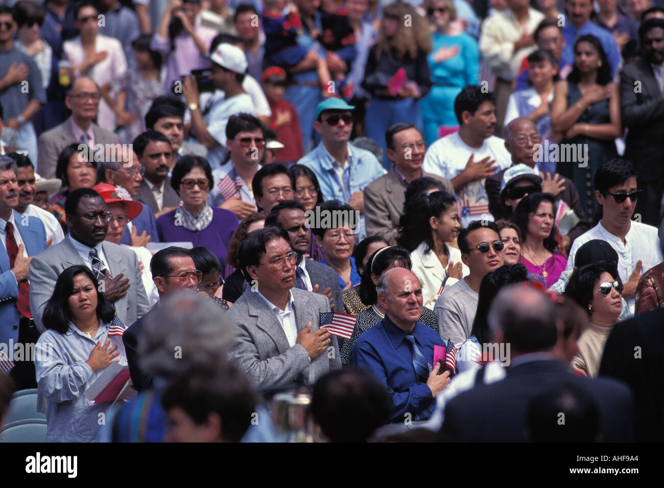 Crowd Of Immigrants Repeat Pledge Of Allegiance During 4th Of July U S Naturalization Ceremony Seattle Washington - Stock Image