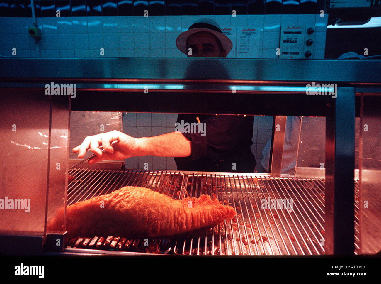 Cooked battered fish at the original Harry Ramsdens fish and chip shop Guiesley Yorkshire. Stock Photo