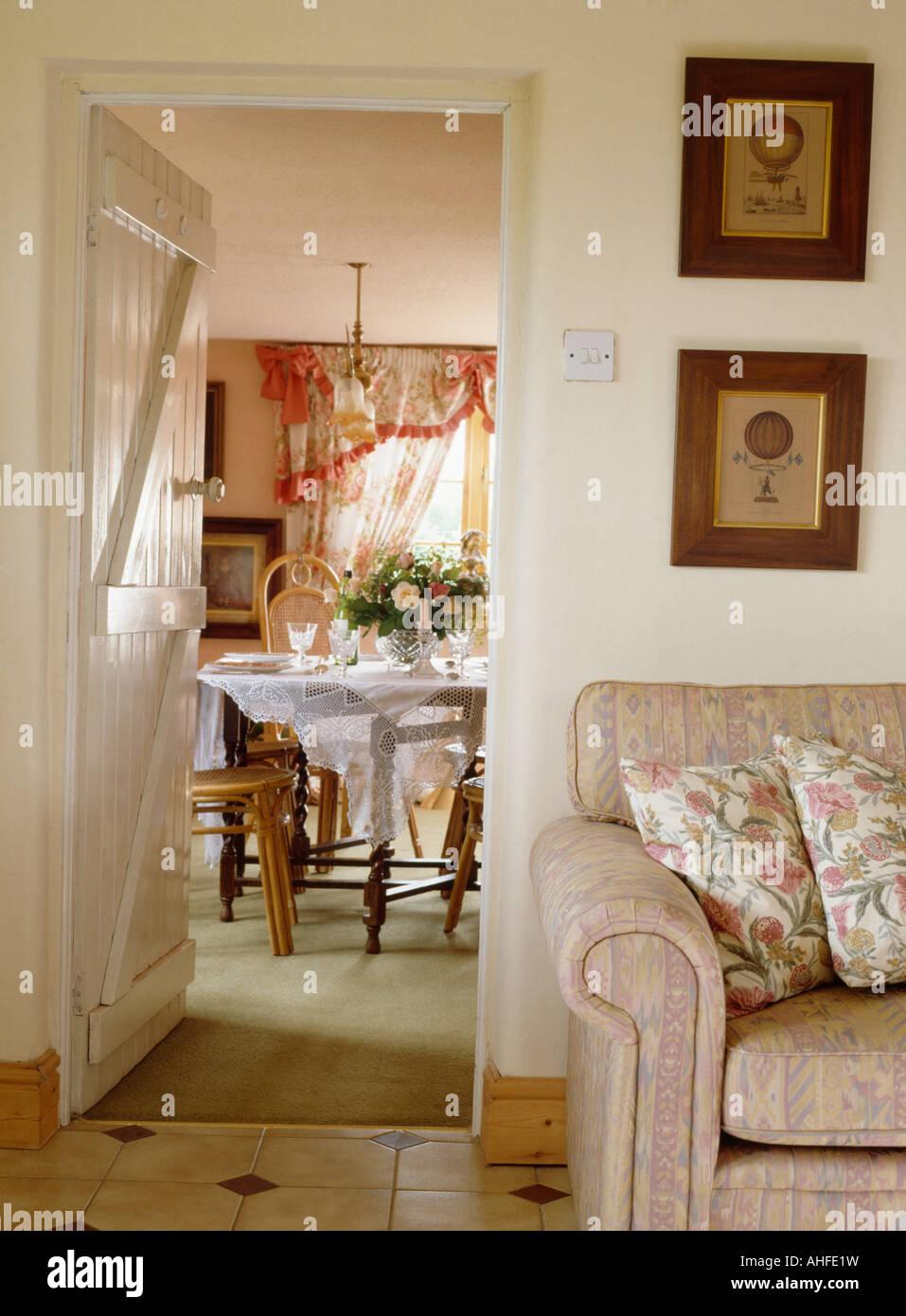 Cottage living room with door open to diningroom - Stock Image