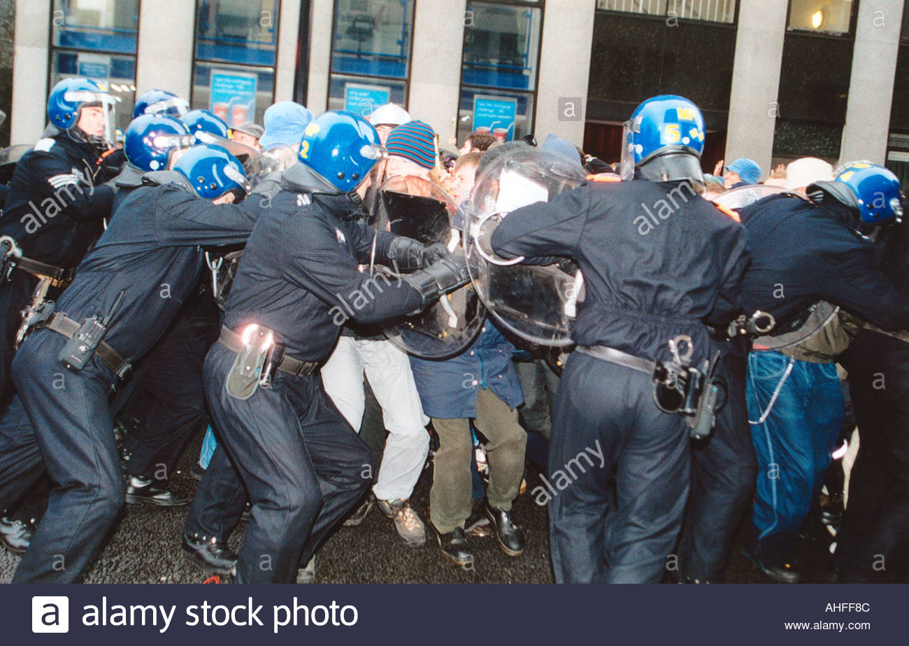 Anti capitalist May Day demo Oxford Circus London Riot police confronting demonstrators UK 1 May 2001 - Stock Image