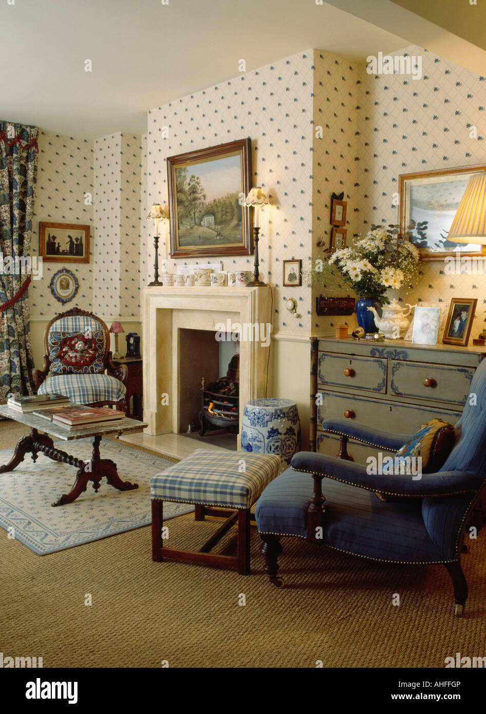 Blue Armchair And Checked Footstool In Living Room With Fireplace And  Spotted Wallpaper
