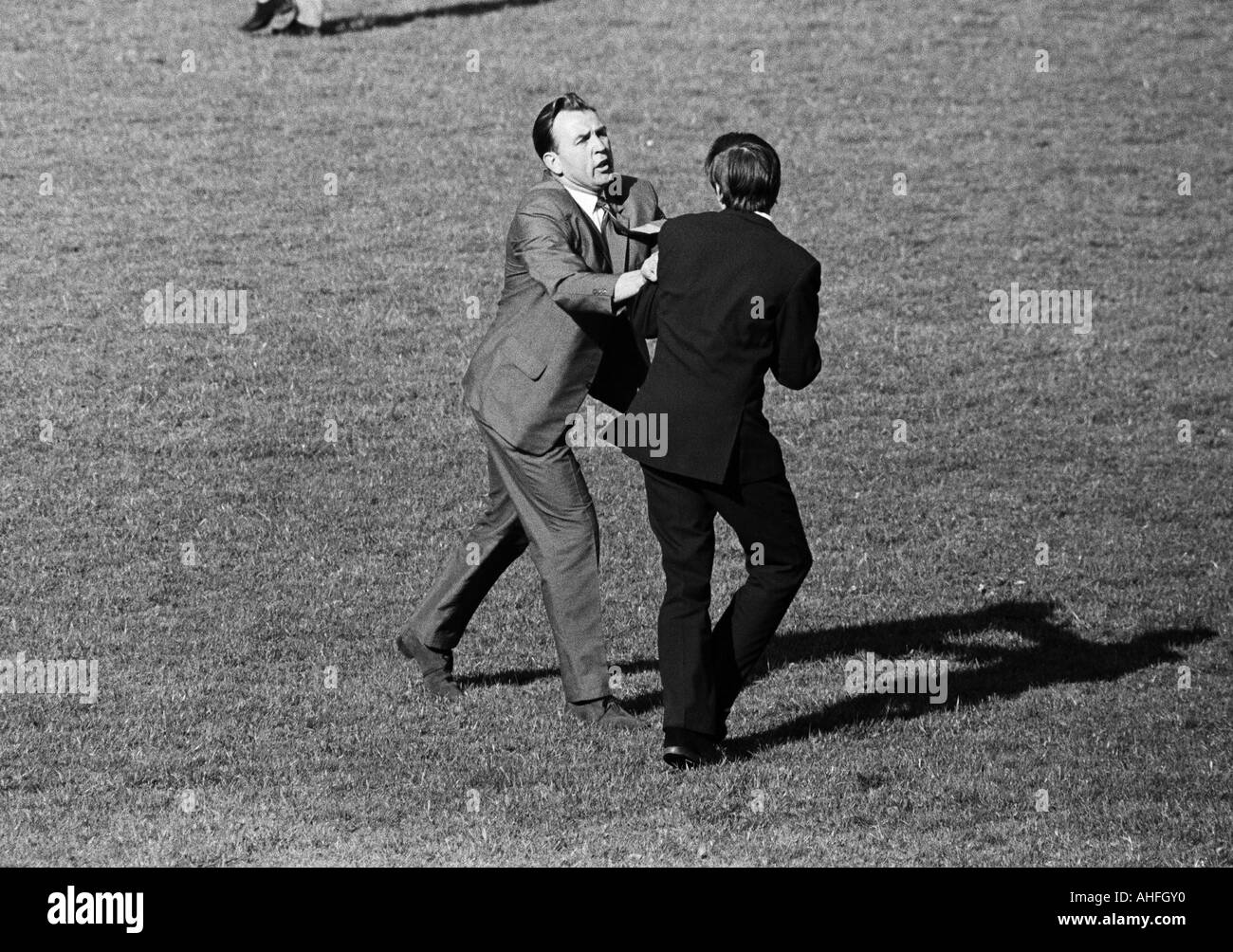football, Regionalliga West, 1965/1966, TSV Marl-Huels versus Fortuna Duesseldorf 0:3, Jahn Stadium in Marl, wrangling between a young football fan and a steward who tries to chase the fan from the pitch - Stock Image