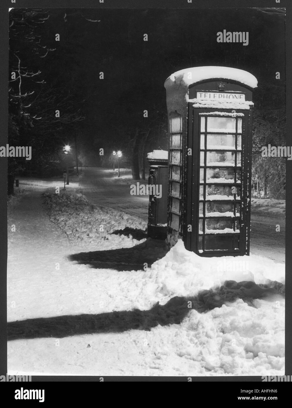 Telephone Kiosk In Snow - Stock Image