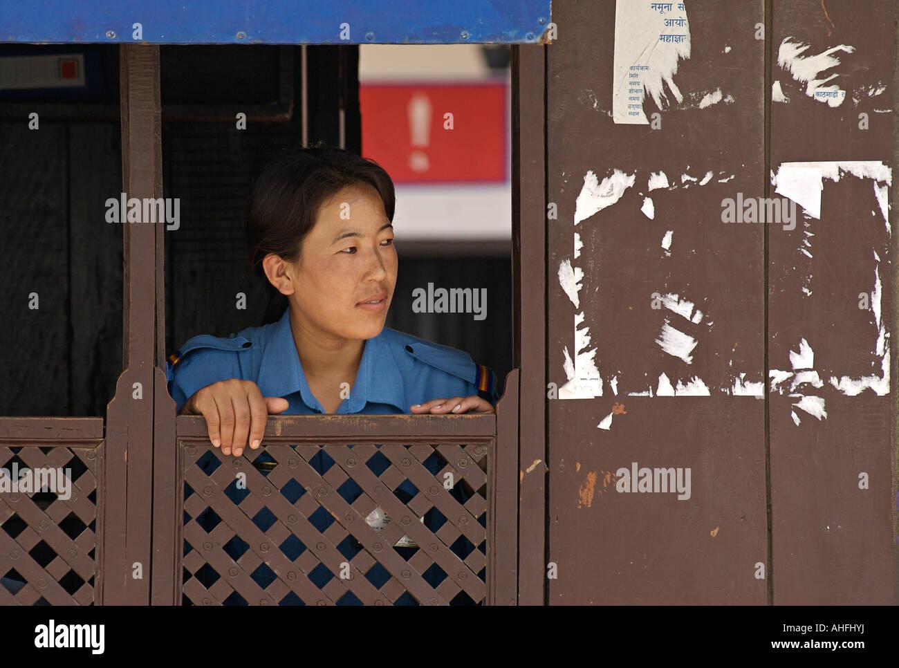 Nepalese police woman at a window Durbar Square Kathmandu Nepal - Stock Image