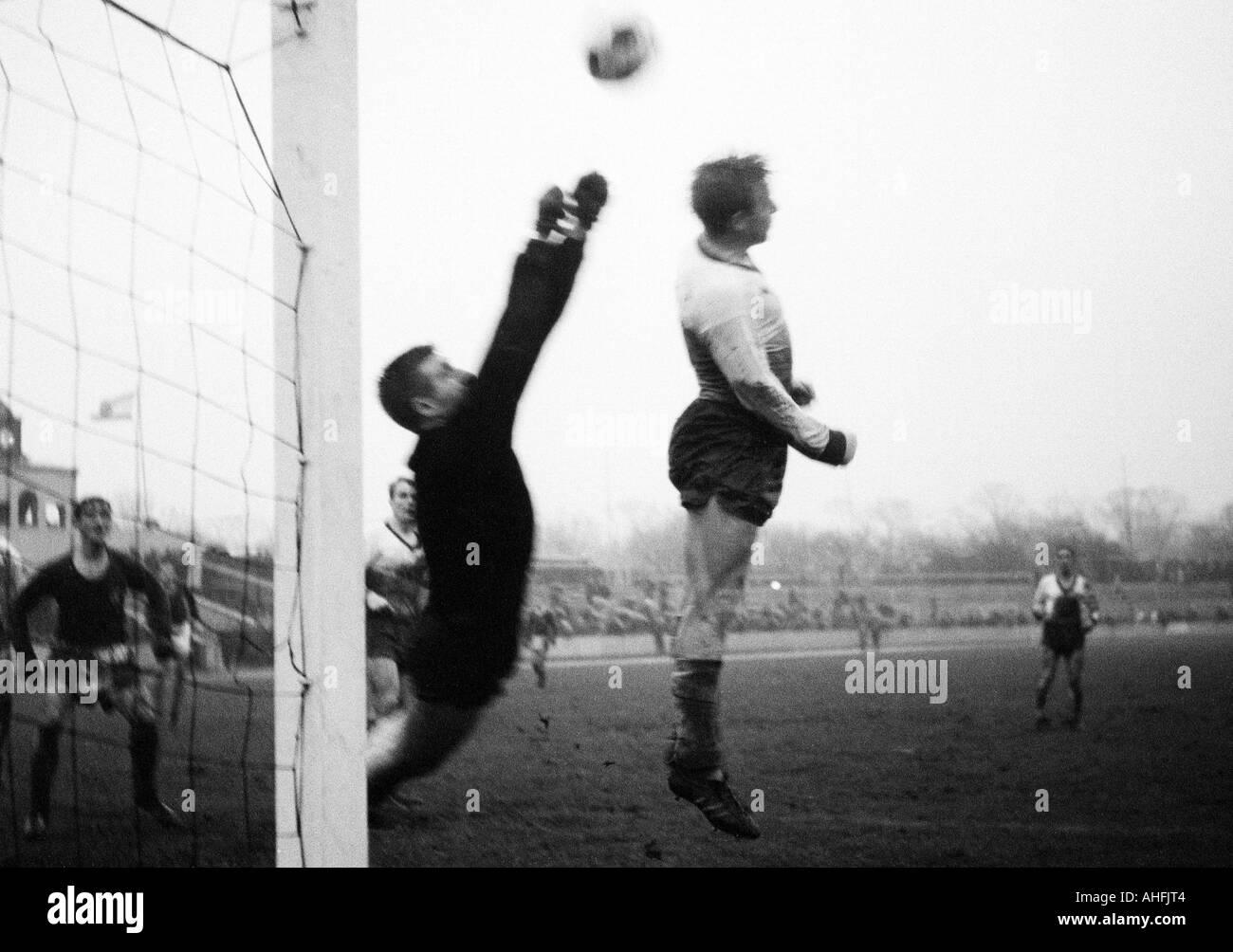 football, Regionalliga West, 1966/1967, Rot-Weiss Oberhausen versus VfL Bochum 4:4, Niederrhein Stadium in Oberhausen, scene of the match, punched clearance by keeper Helmut Traska (RWO) left, right Albert Eichholz (RWO) - Stock Image