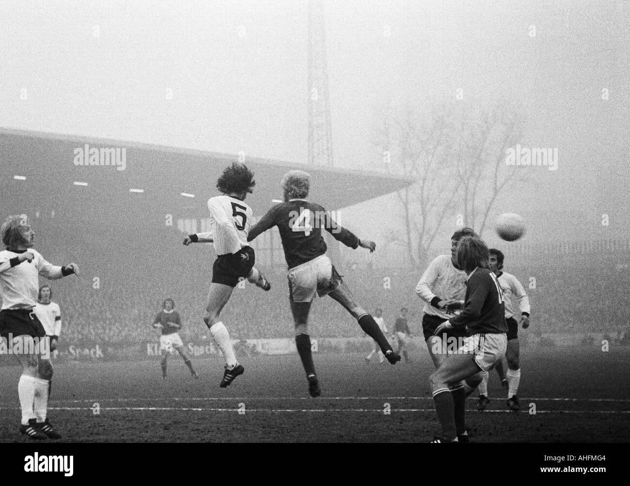 football, Bundesliga, 1971/1972, FC Schalke 04 versus Eintracht Frankfurt 2:0, Glueckaufkampfbahn Stadium in Gelsenkirchen, scene of the match, left Horst Heese (Frankfurt), in the middle Rolf Ruessmann (S04, 4) - Stock Image