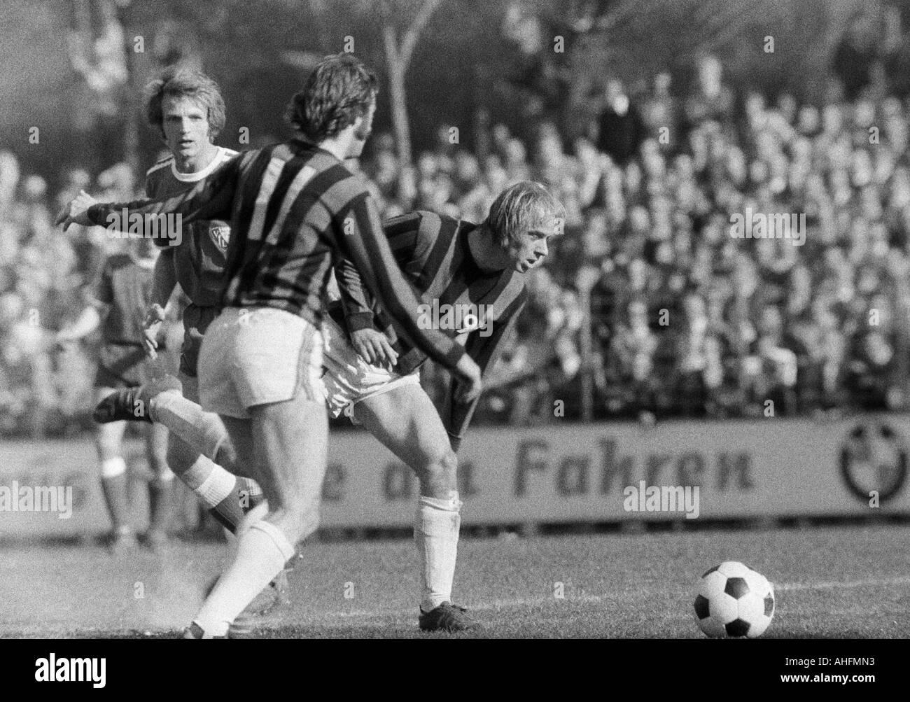 football, Bundesliga, 1971/1972, VfL Bochum versus Hanover 96 2:2, Stadium at the Castroper Strasse in Bochum, scene of the match, f.l.t.r. Dieter Zorc (Bochum), a Hannover player (11), Horst Bertl (96) - Stock Image