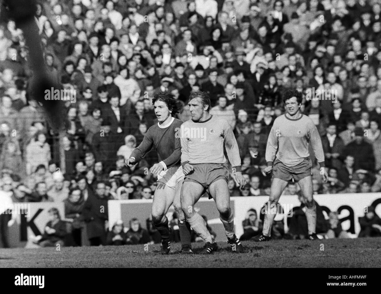 football, Bundesliga, 1971/1972, FC Schalke 04 versus Eintracht Brunswick 5:1, Glueckaufkampfbahn Stadium in Gelsenkirchen, scene of the match, f.l.t.r. Klaus Fischer (S04), Peter Kaack (BS), Friedhelm Haebermann (BS) - Stock Image