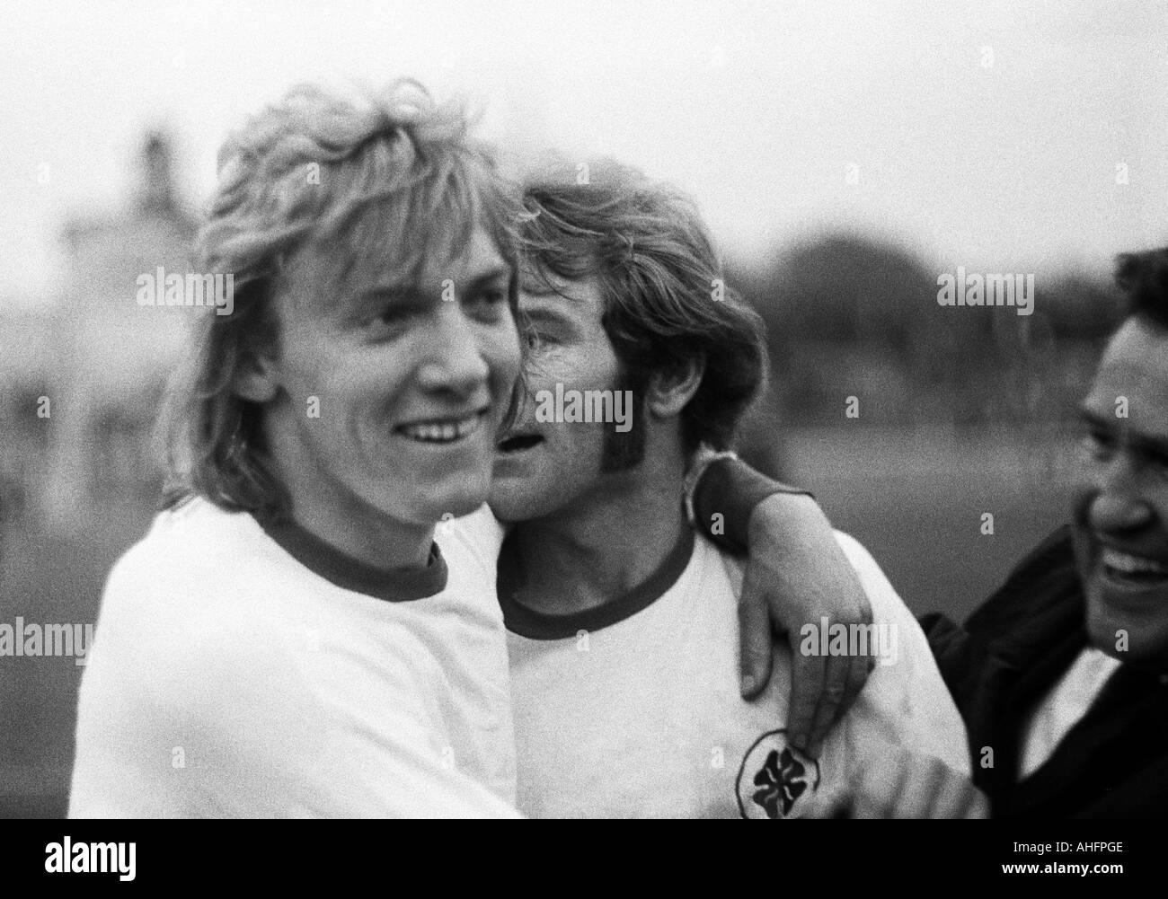 football, Bundesliga, 1972/1973, Rot-Weiss Oberhausen versus Eintracht Frankfurt 1:0, Niederrhein Stadium in Oberhausen, football players rejoicing, left Jupp Tenhagen (RWO), right Willi Mumme (RWO) - Stock Image