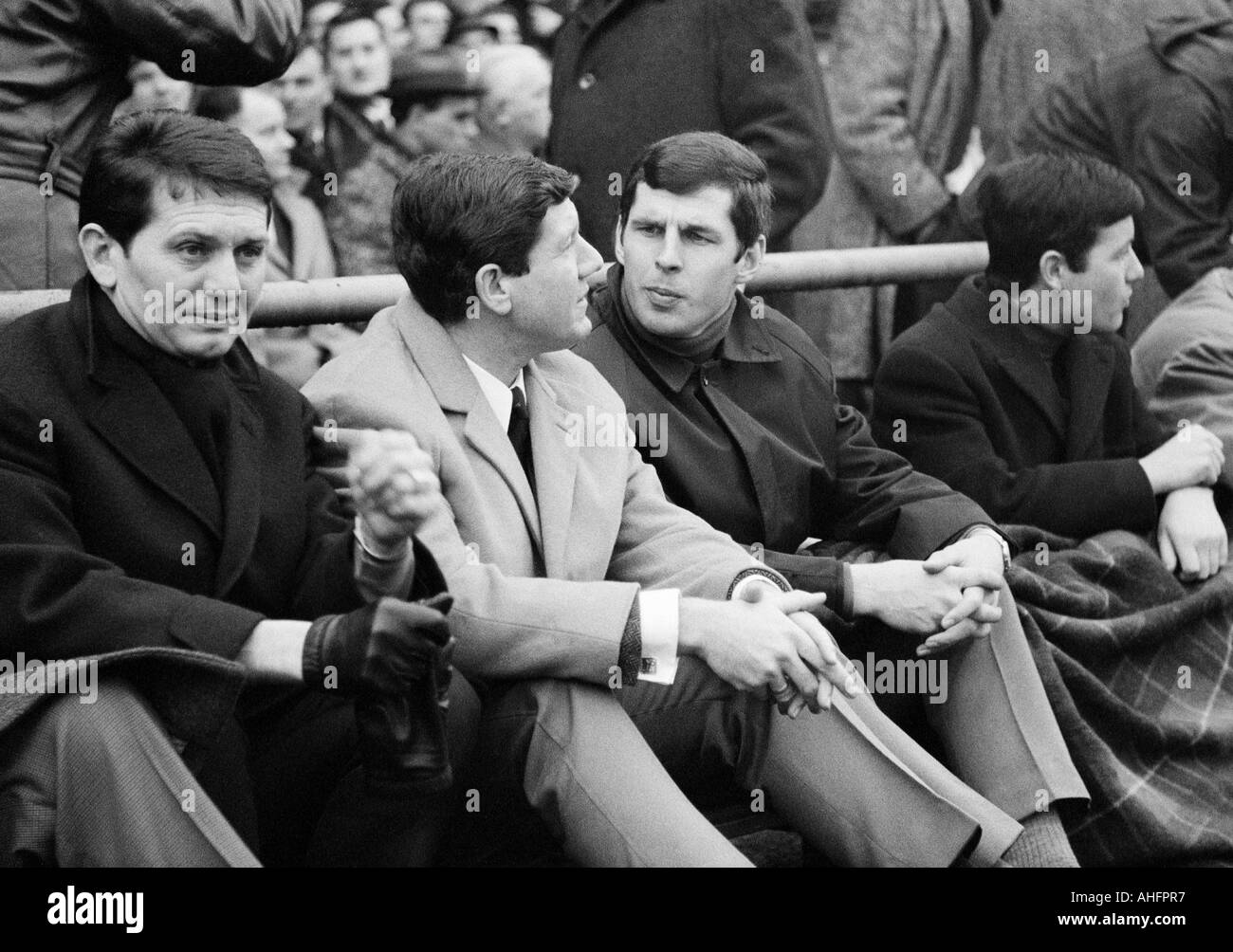 football, Bundesliga, 1967/1968, FC Schalke 04 versus 1. FC Cologne 1:1, Glueckaufkampfbahn Stadium in Gelsenkirchen, visitors sitting in the stand, Horst Szymaniak and Lothar Emmerich - Stock Image