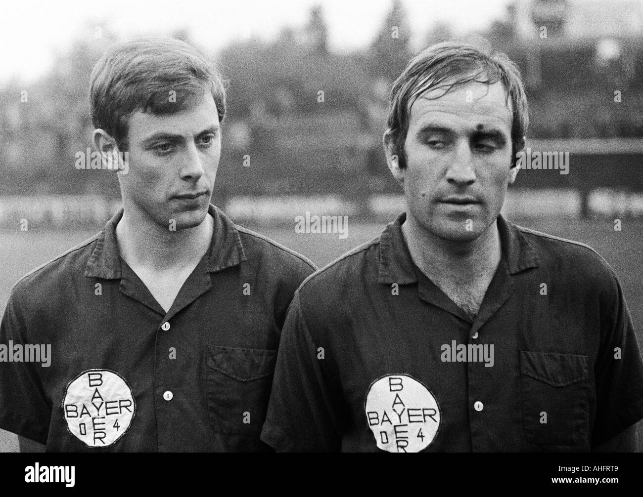 football, Regionalliga West, 1967/1968, Stadium am Uhlenkrug in Essen, ETB Schwarz-Weiss Essen versus Bayer Leverkusen 3:3, football players leaving the pitch, left Karl Heinz Bruecken (Leverkusen), right Helmut Richert (Leverkusen) - Stock Image