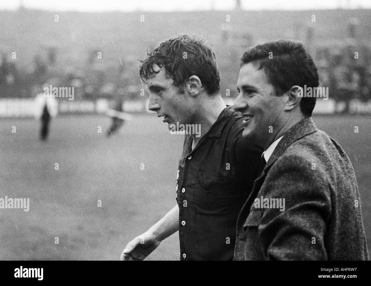 football, Regionalliga West, 1967/1968, Stadium am Uhlenkrug in Essen, ETB Schwarz-Weiss Essen versus Bayer Leverkusen 3:3, football players, left Guenter Haarmann (Leverkusen), right Fredi Henneken (Leverkusen) in civvies - Stock Image